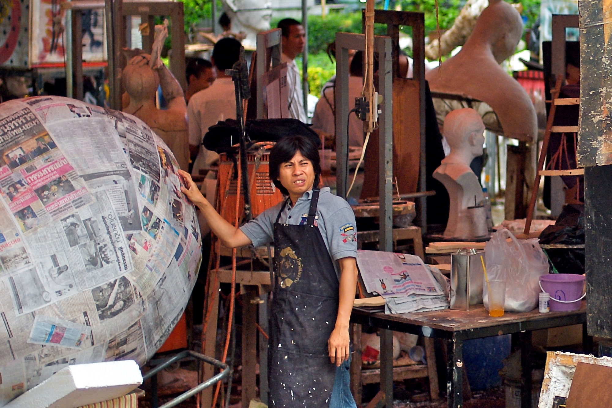 Sculptor with globe