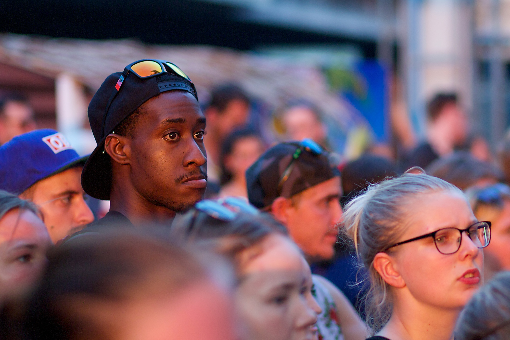 man in crowd, watching anxiously