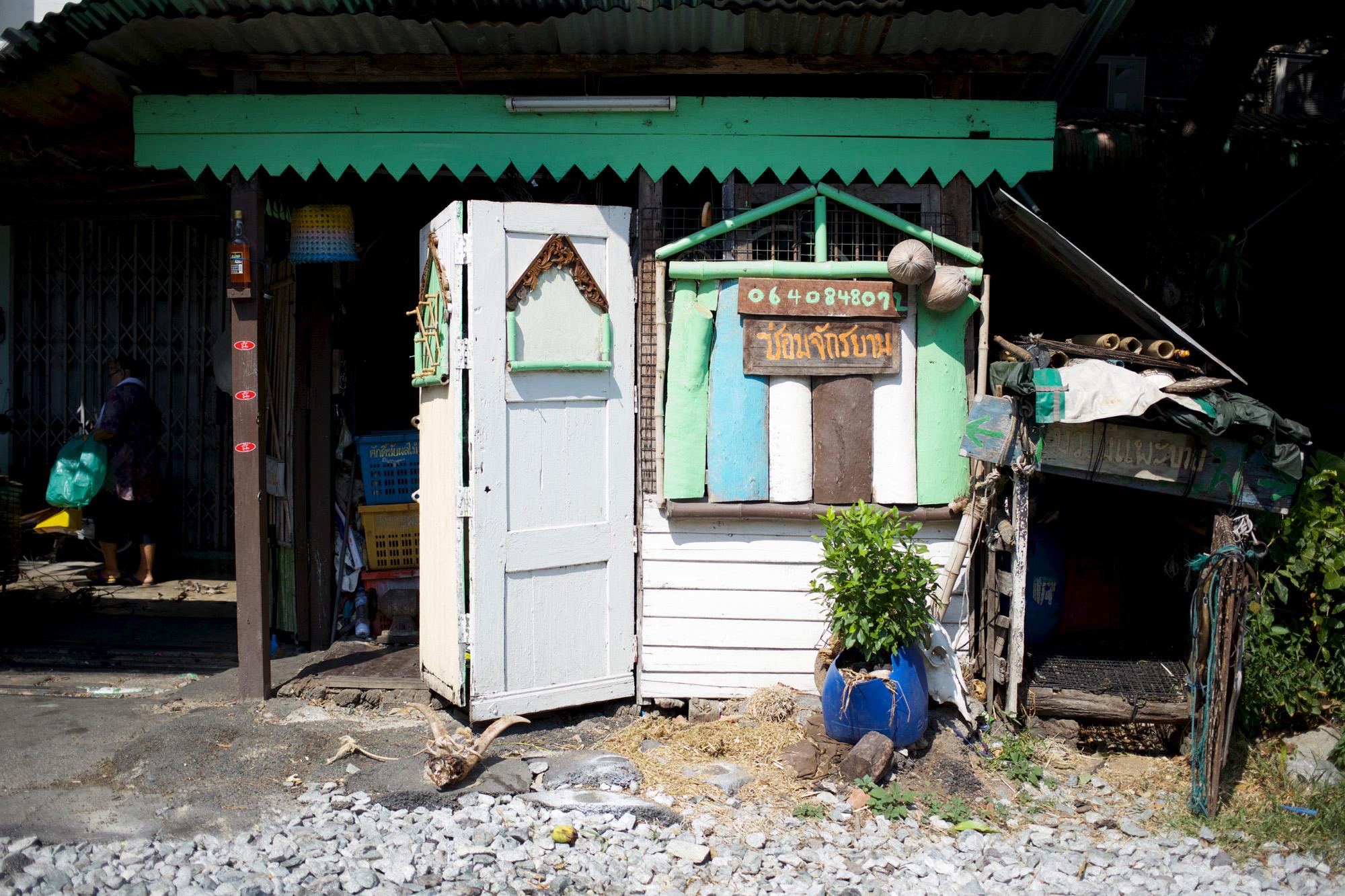 green hut near railway line