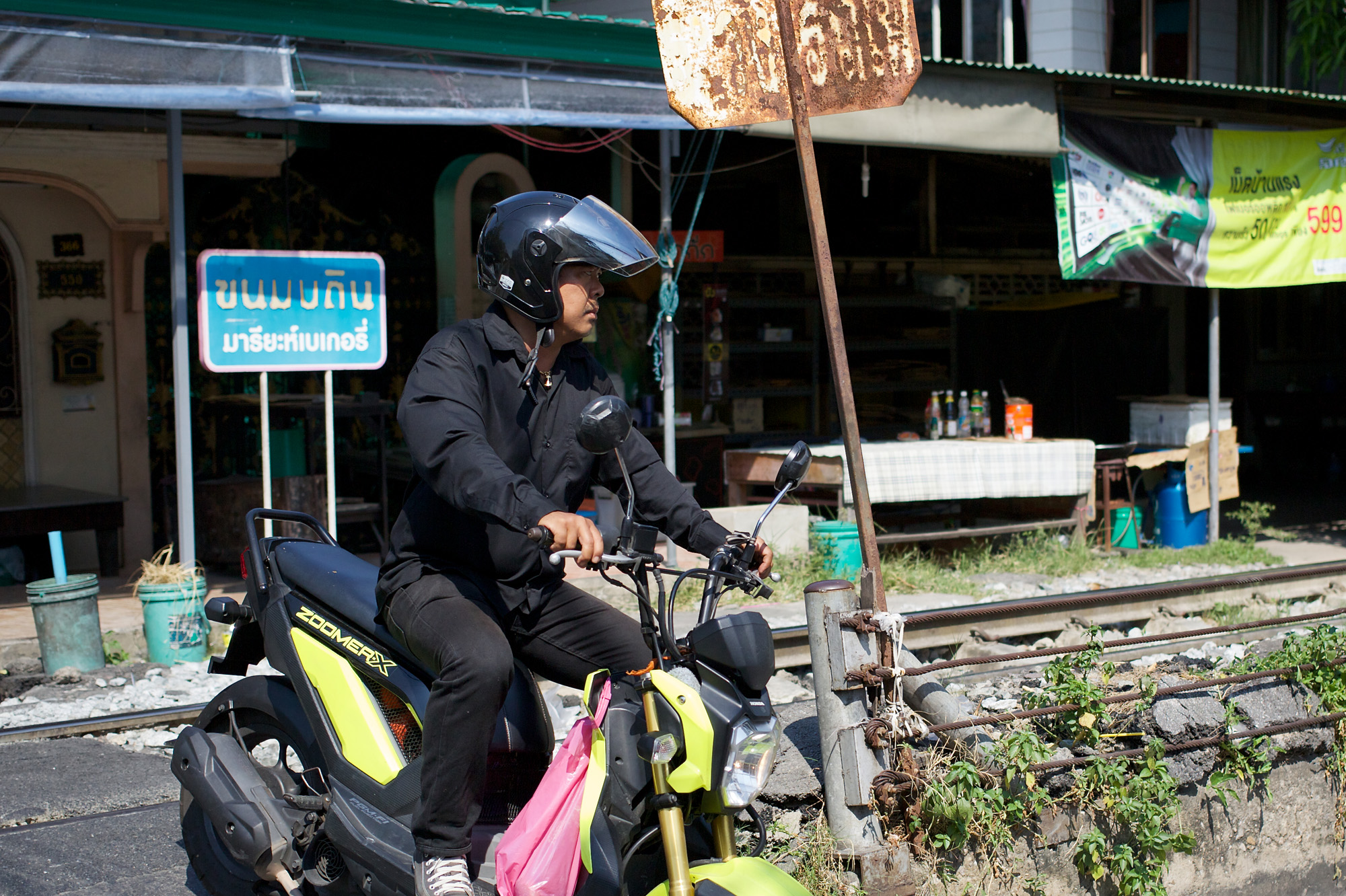 scooter crossing rail at Wongwian Yai