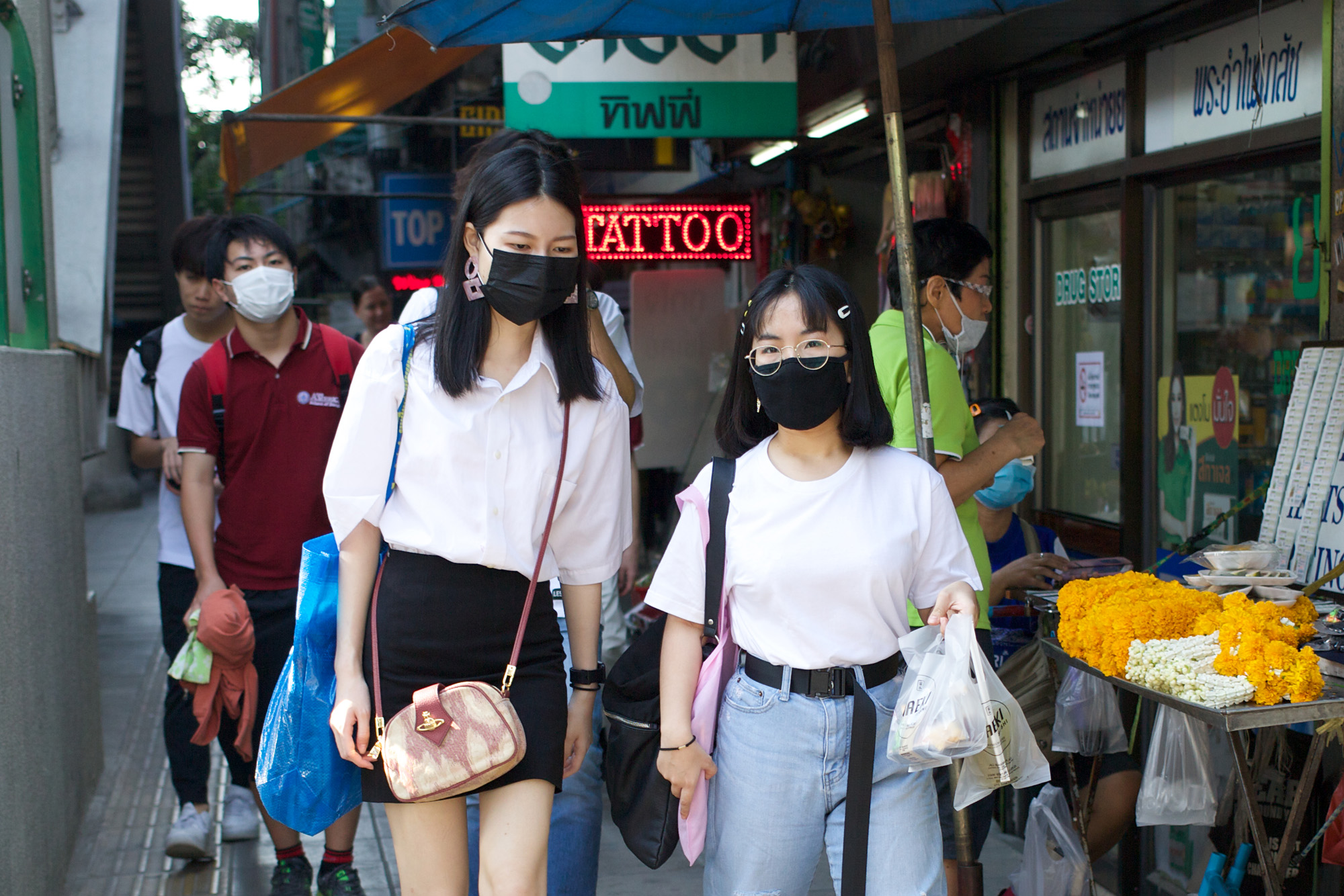 several people wearing masks