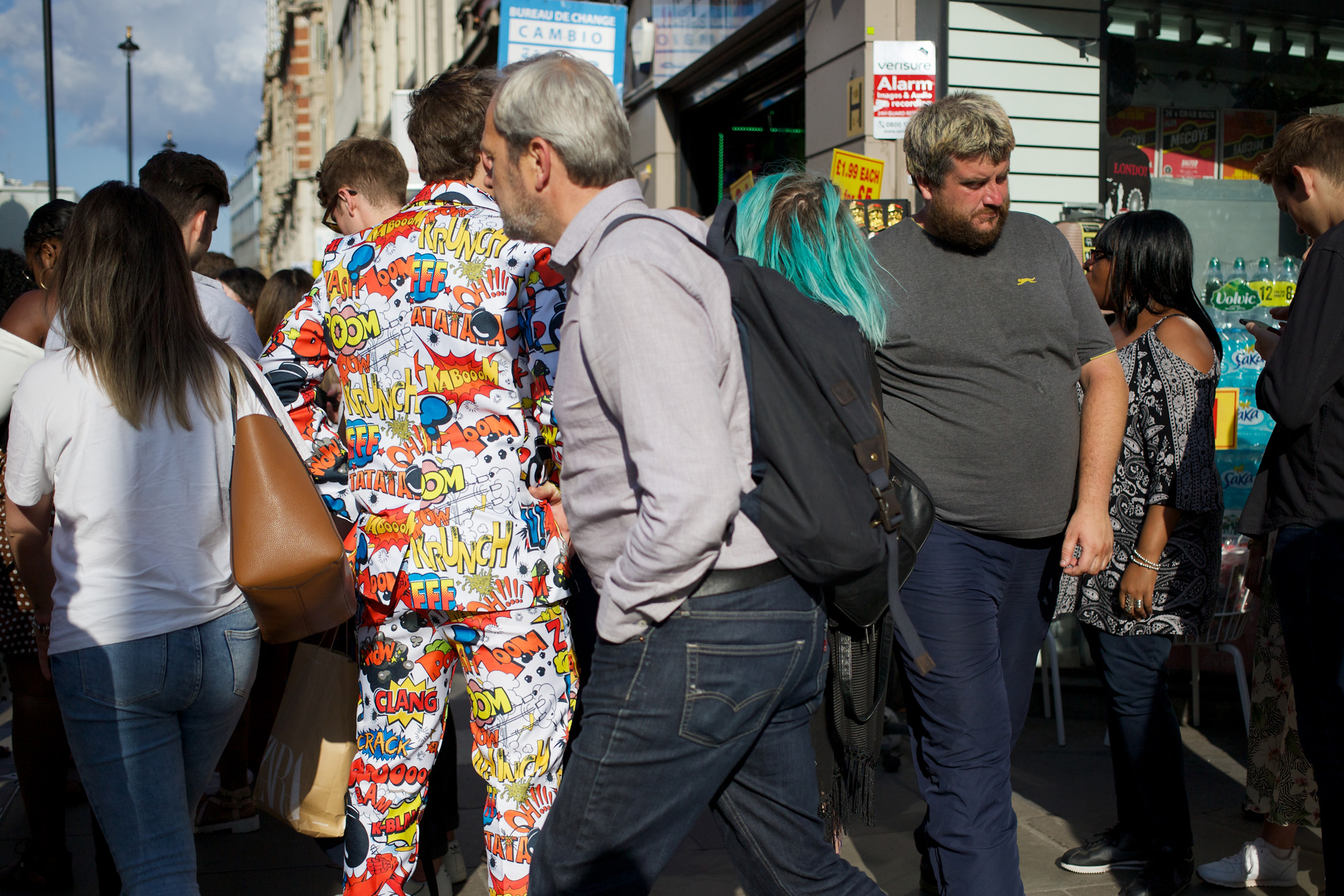 man in bizarre suit with cartoon exclamations all over it