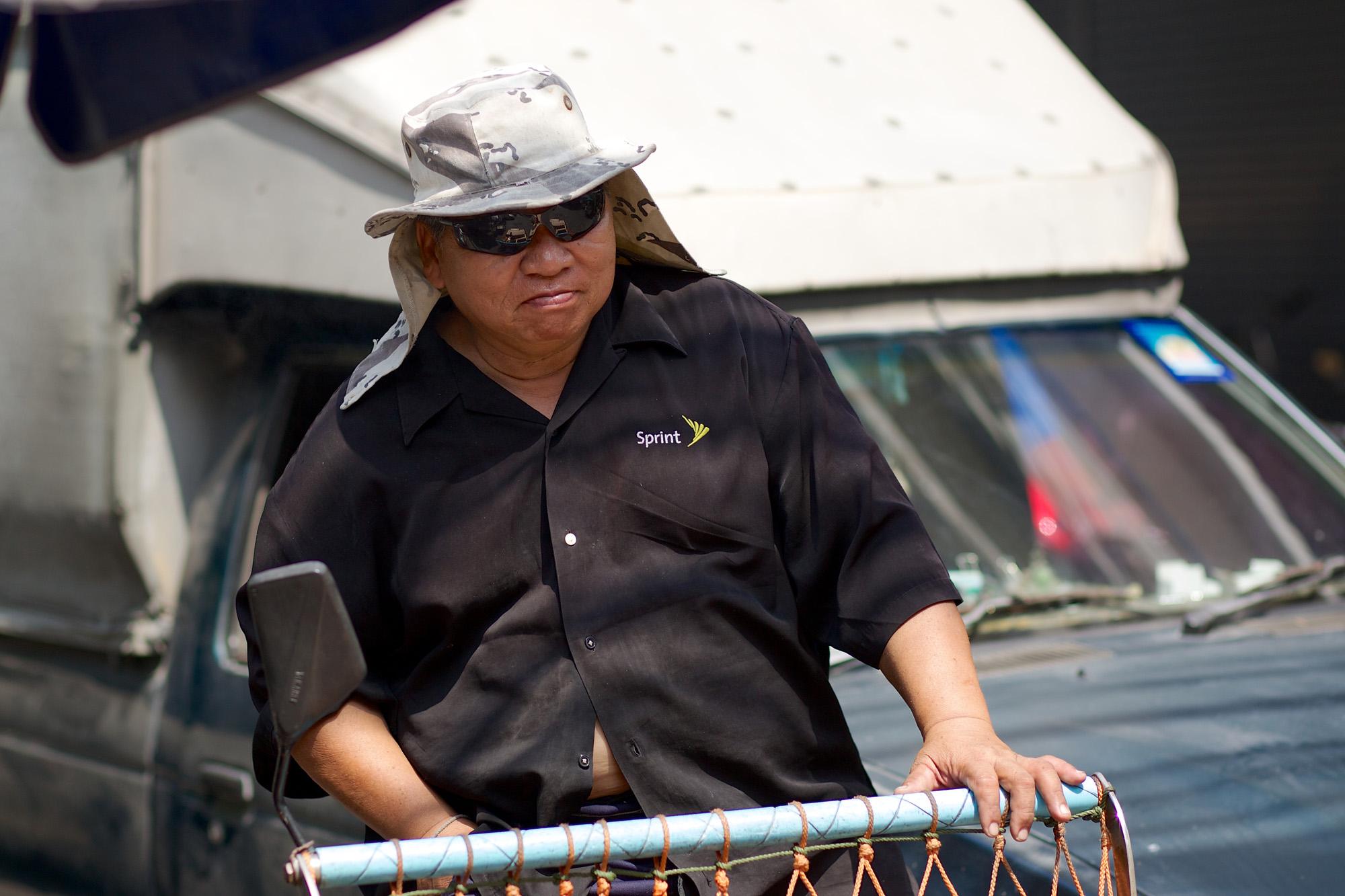 workman pushing a cart