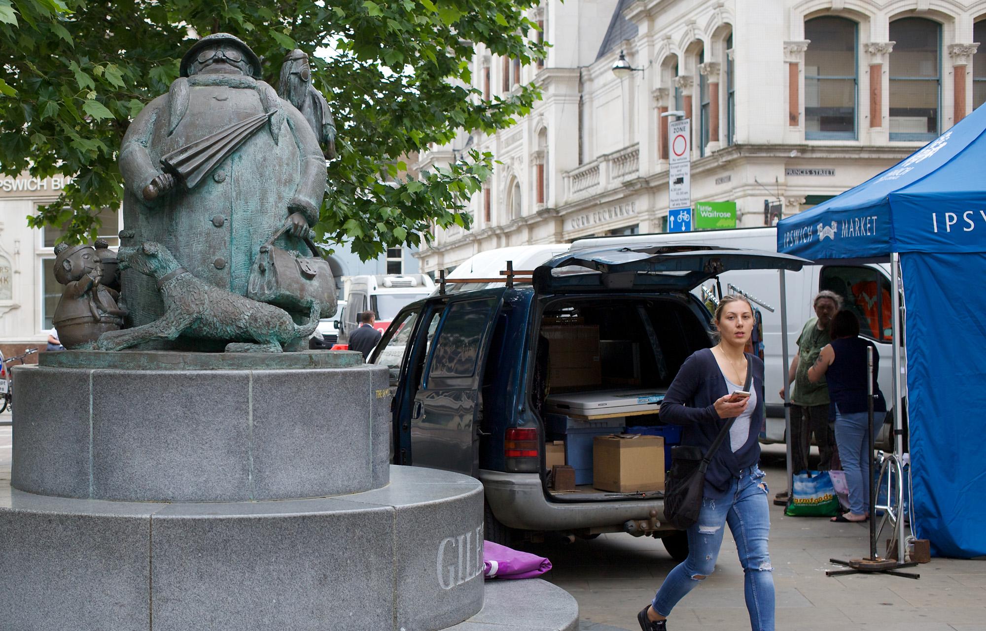 statue near market stalls