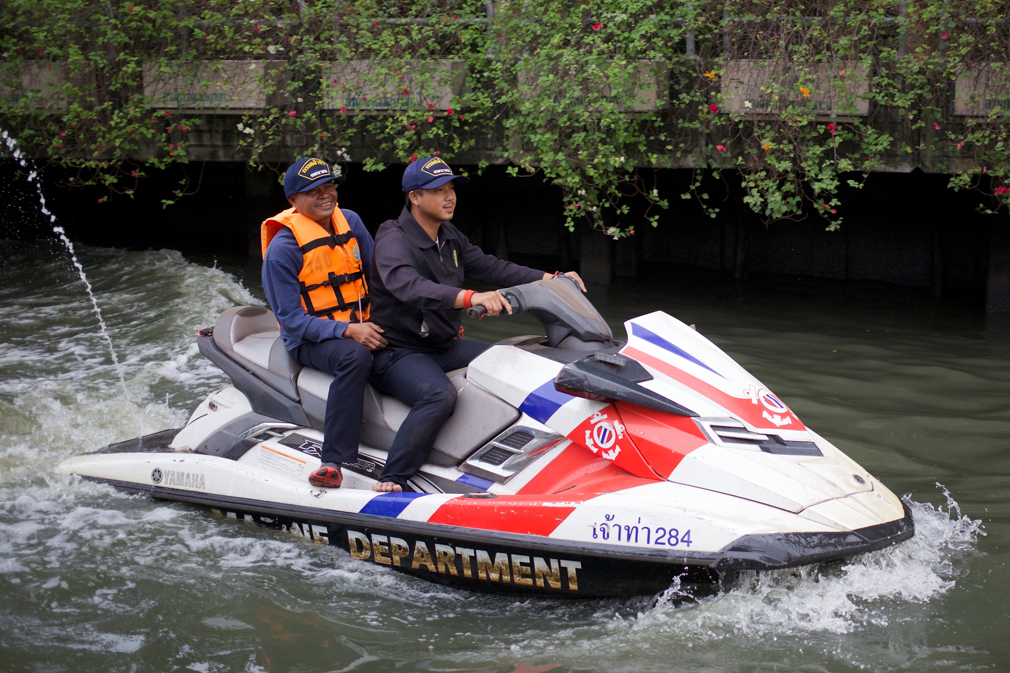 Two officials from the marine department on a jet ski