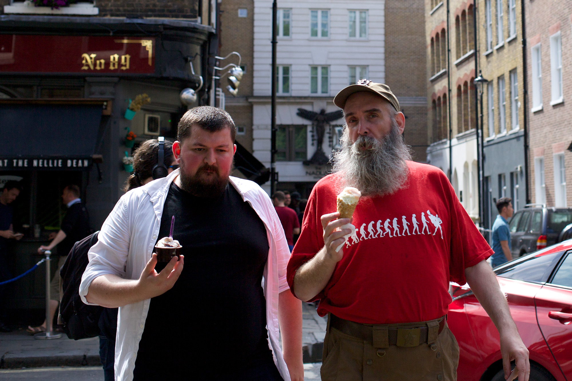 Two men in stylish gear, holding ice creams