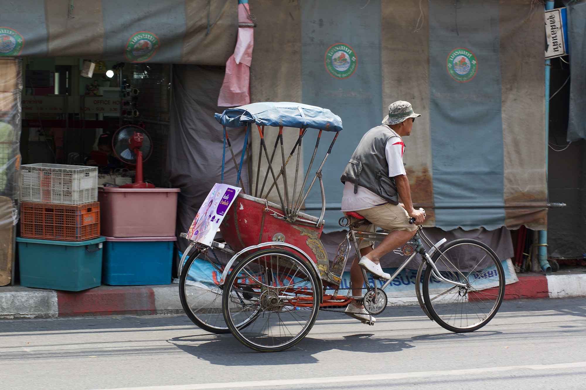 man on rickshaw