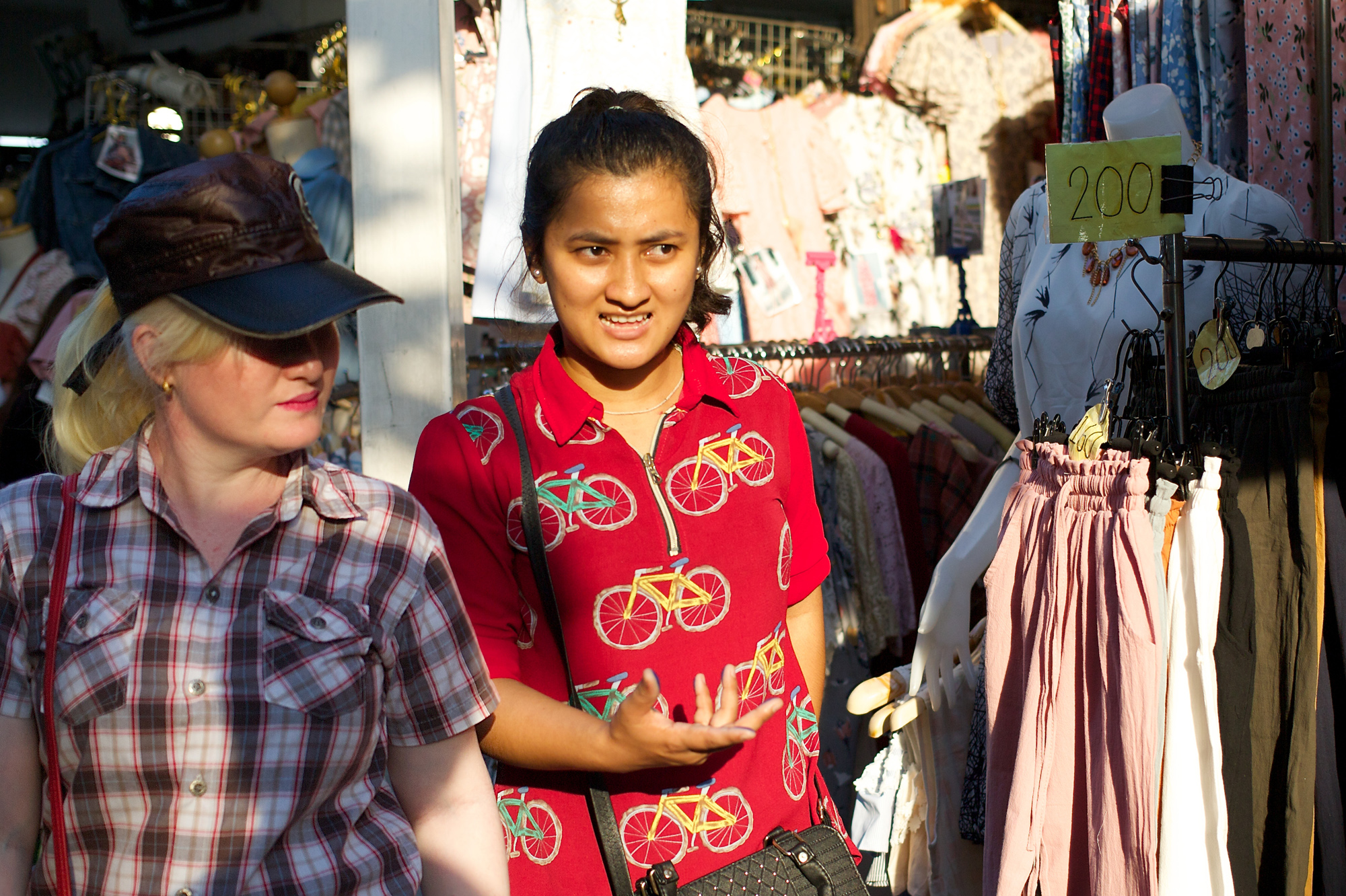 girl in red shirt with bicycle pattern