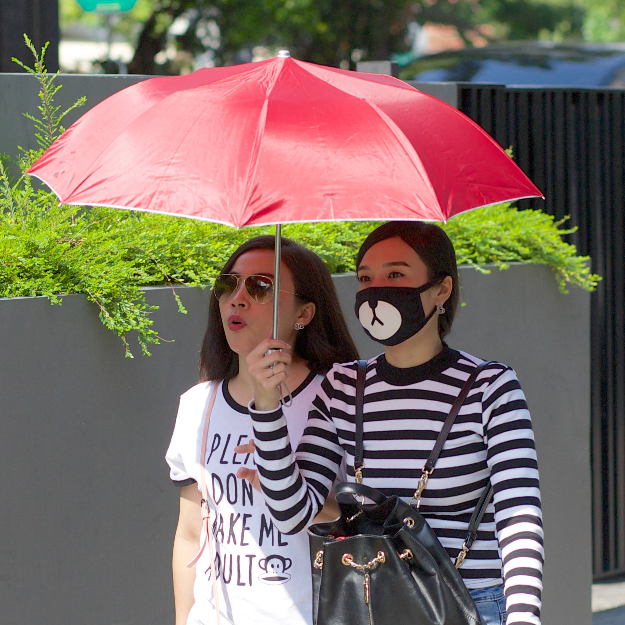 two women, one dwith animal mask