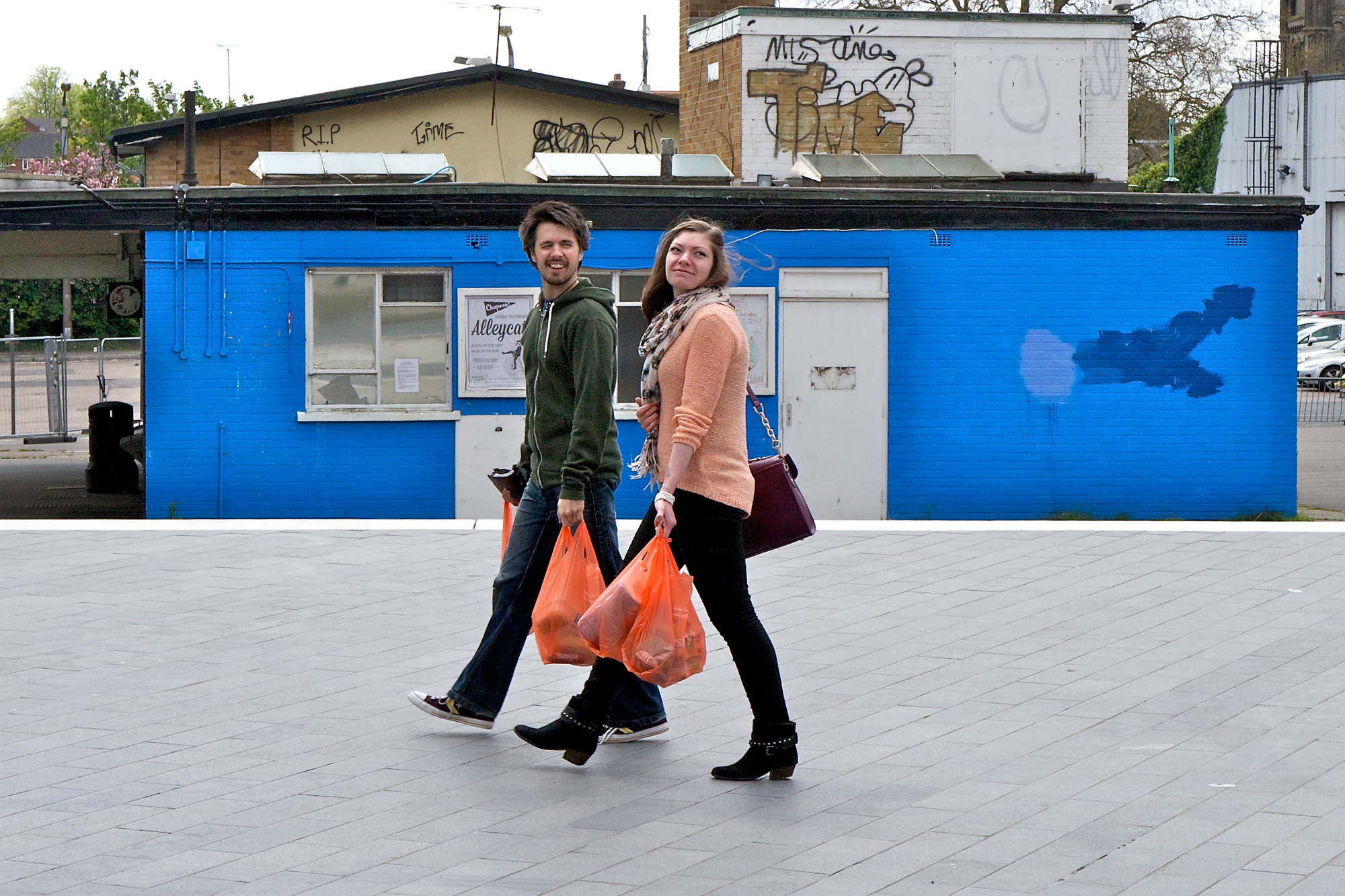 Couple with four bright orange bags